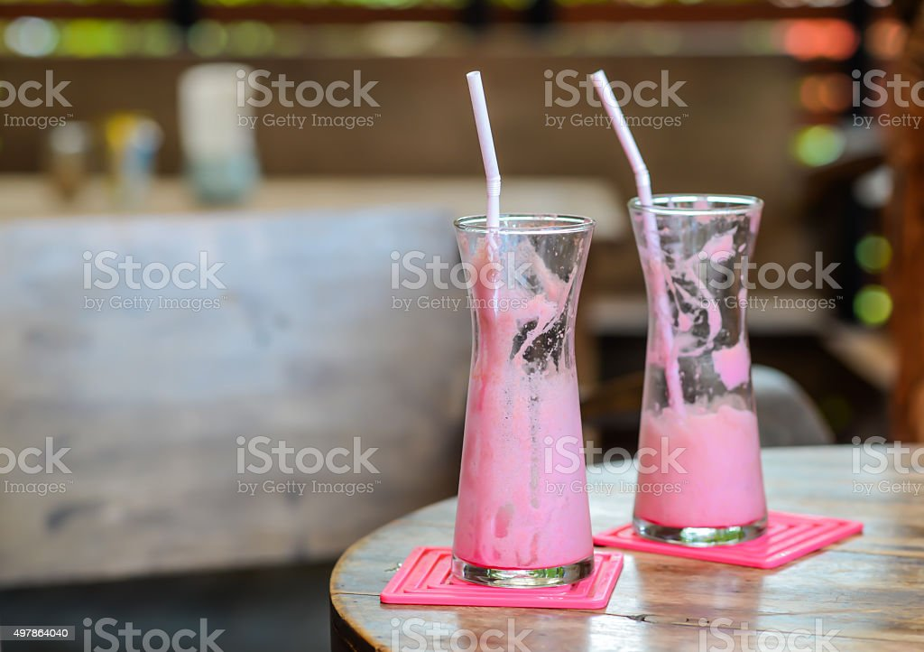 Frappe pink milk.Strawberry Smoothie. stock photo