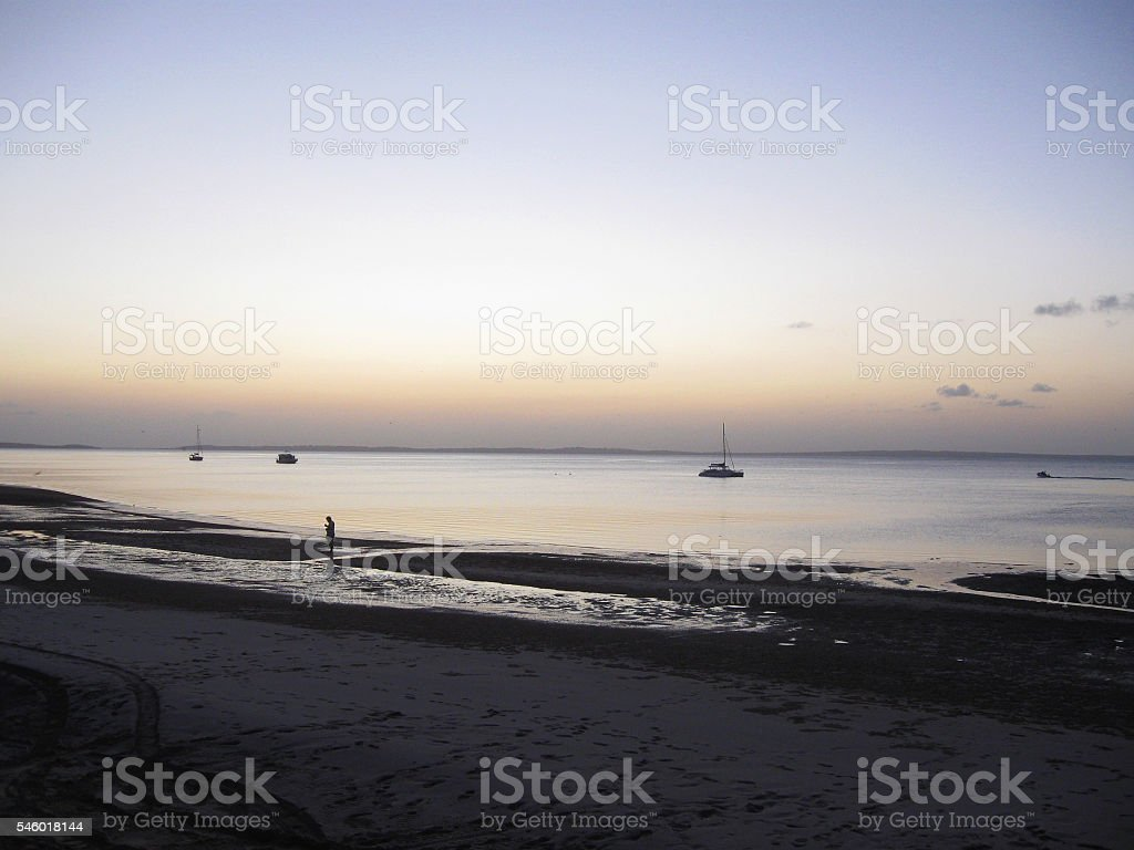 Fraser Island Sunset, Silouette of boats stock photo