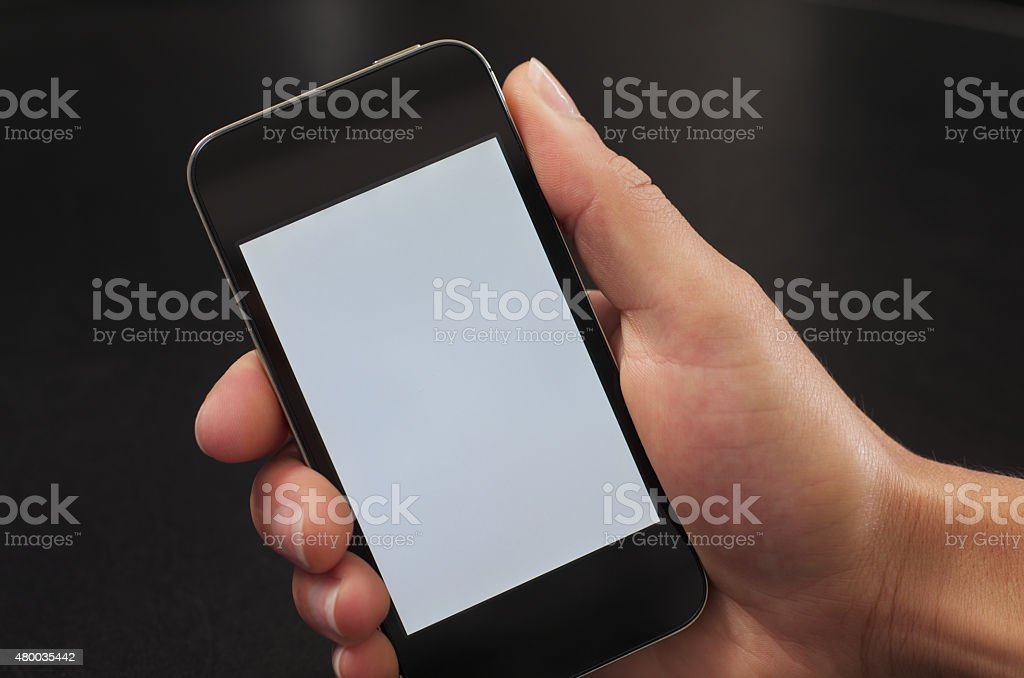 Frau hält Mobiltelefon in einer Hand - Woman holding cellphone stock photo