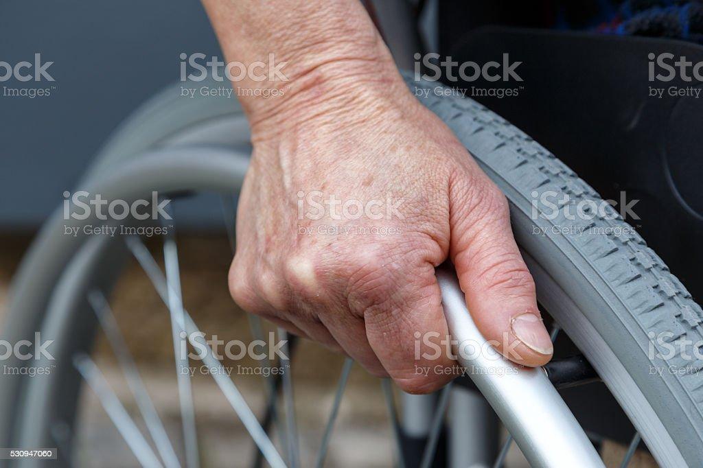Frau im Rollstuhl stock photo
