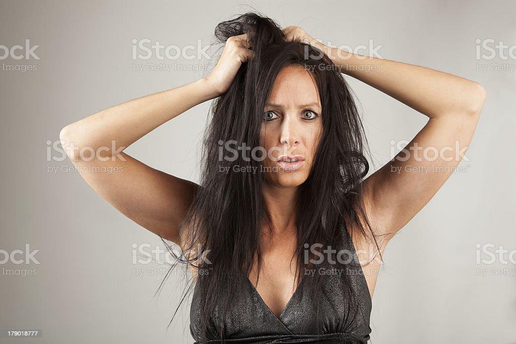 Frau rauft sich die Haare stock photo