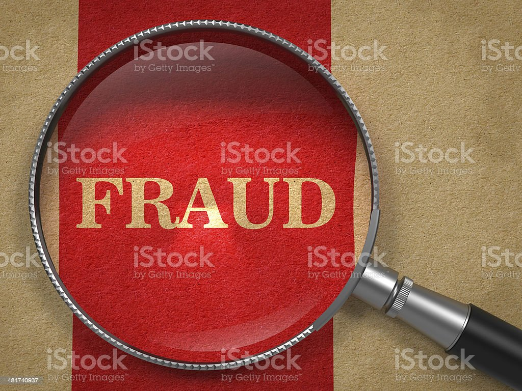 Fraud Concept - Magnifying Glass. stock photo