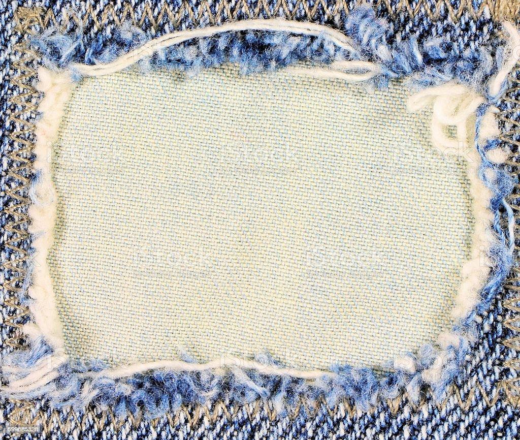 Frayed denim frame. Copy space. stock photo