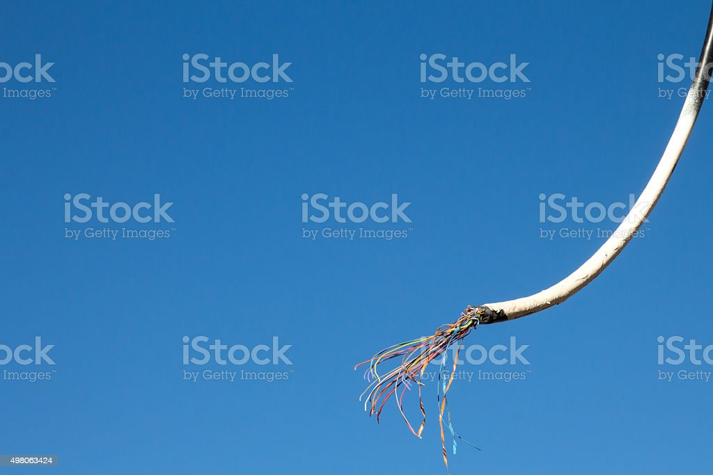 Frayed overhead wire stock photo