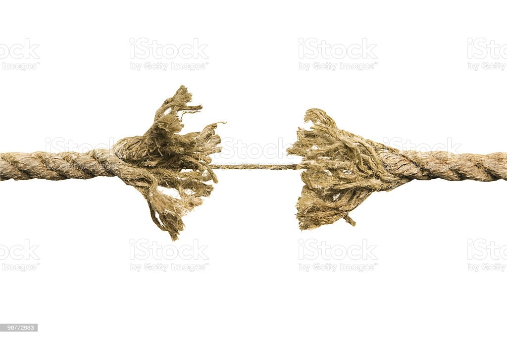 Frayed rope at point of breaking stock photo