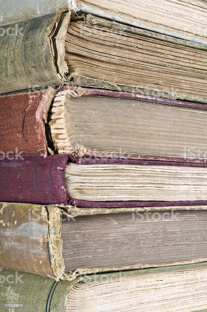 Frayed Spines and Pages on Stack of Old Books royalty-free stock photo