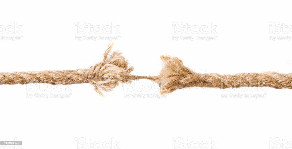 Frayed tan rope, nearly broken stock photo