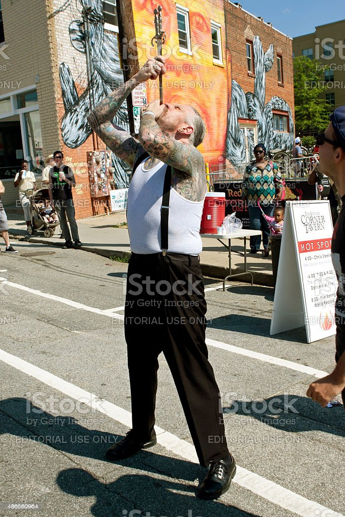 Freak Show Artist Swallows Two Swords In Atlanta Festival stock photo