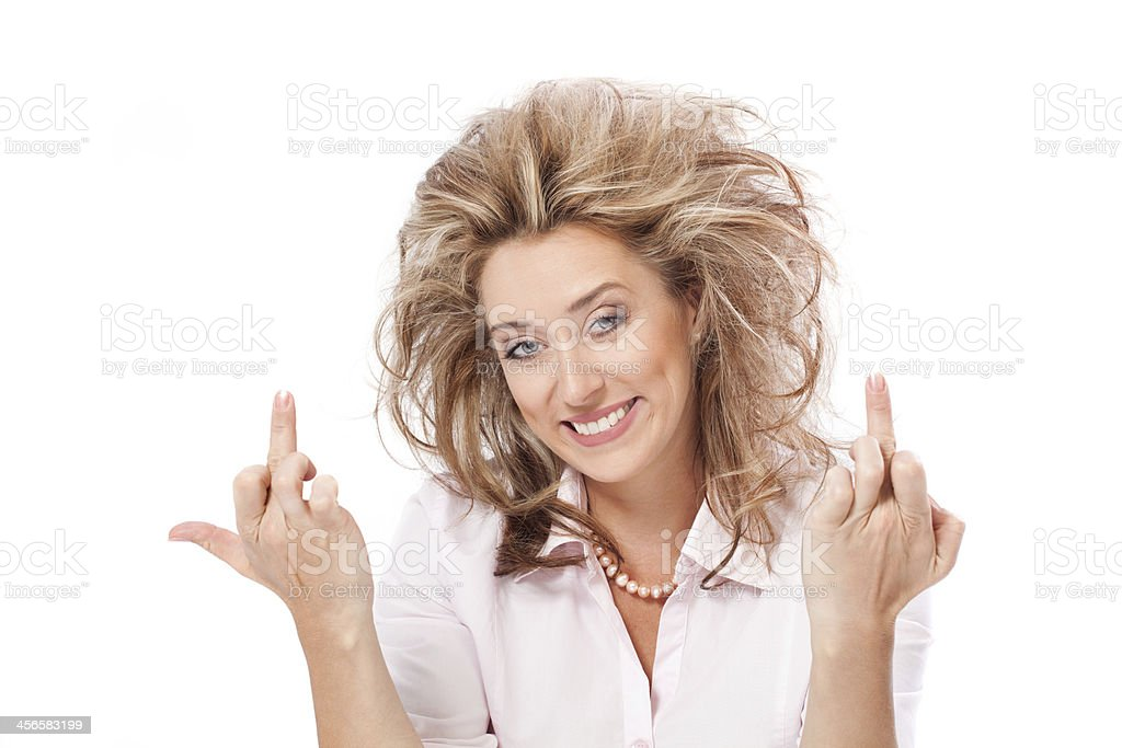 Freaked out woman showing middle finger and smile stock photo