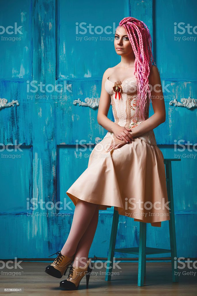 Freaky young woman in vintage corset stock photo