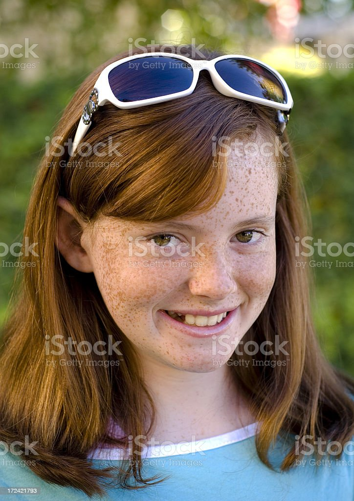 Freckle Face Redhead Child, Pre Adolescent Girl Smiling Wearing Sunglasses stock photo