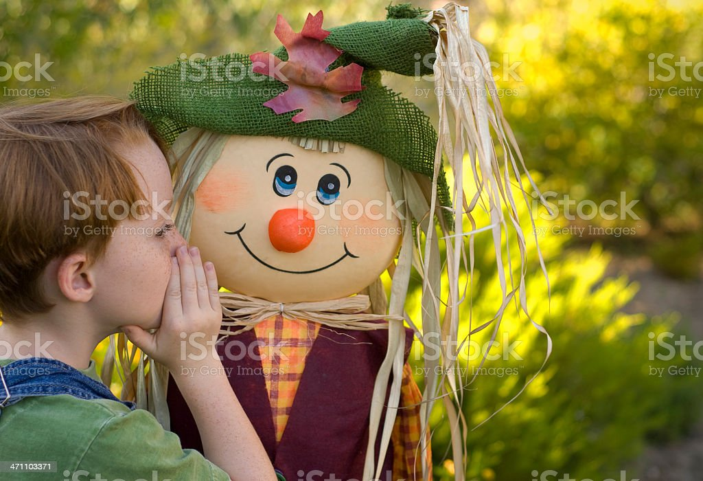 Freckle Face Redhead Child Whispering, Happy Boy & Halloween Scarecrow Costume royalty-free stock photo
