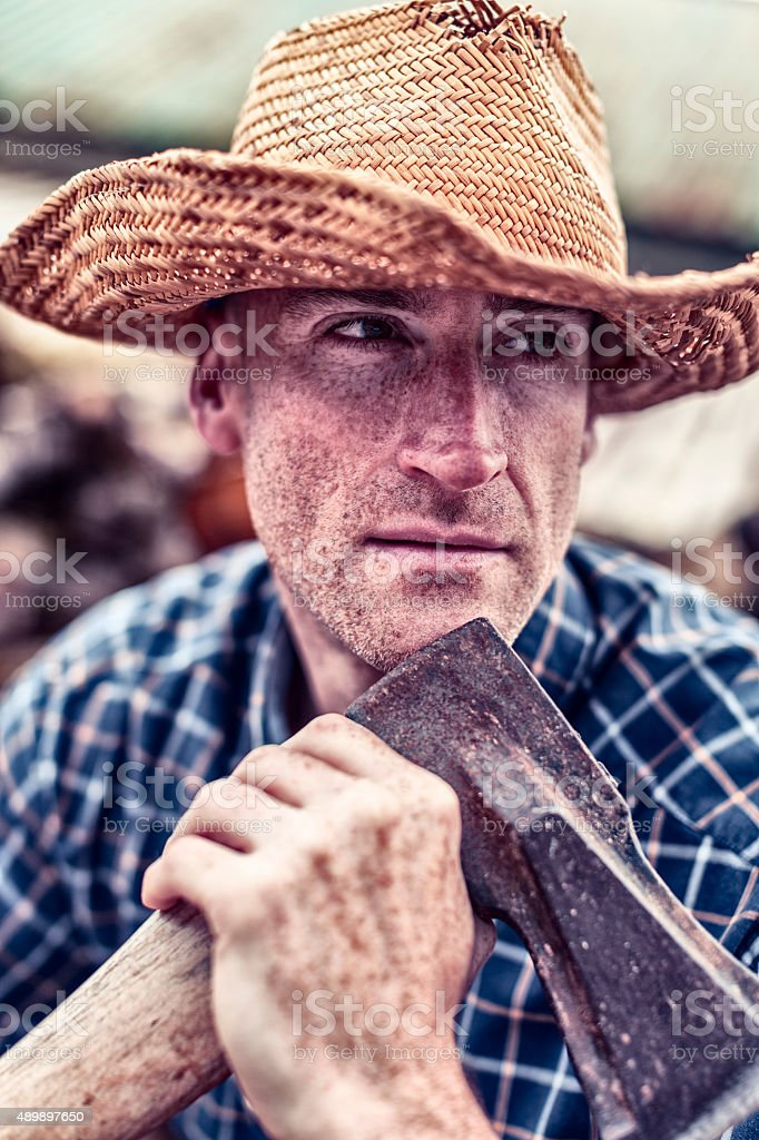Freckle Faced Lumberjack Wearing A Straw Hat stock photo