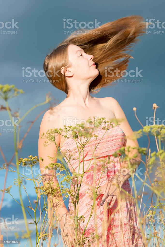 Freckled Woman With Floating Hair in Meadow royalty-free stock photo