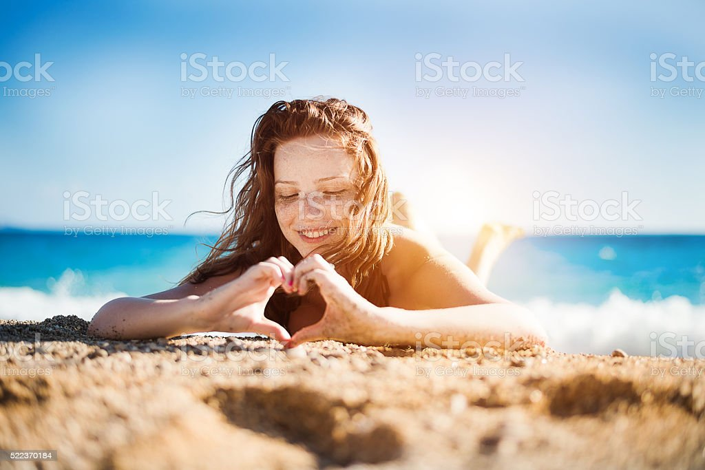 Freckles girl on coast stock photo