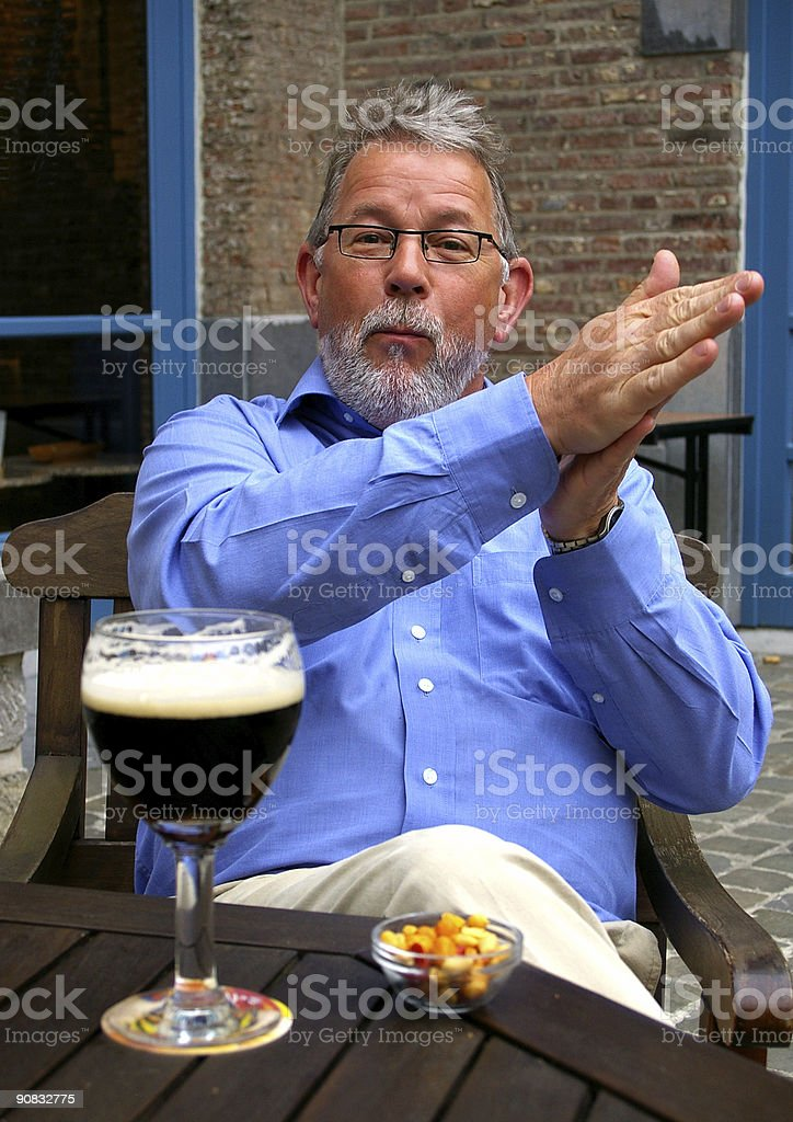 Fred enjoying his beer stock photo