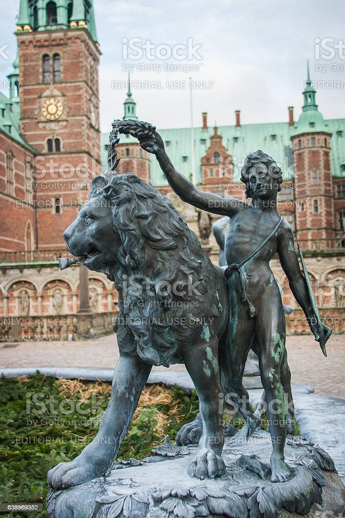 Fredericksborg Castle Neptune Fountain boy crowning lion stock photo