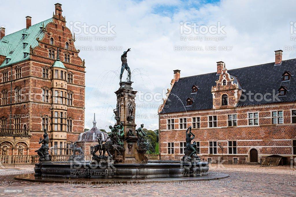 Frederiksborg Castle and Neptune Fountain Square stock photo
