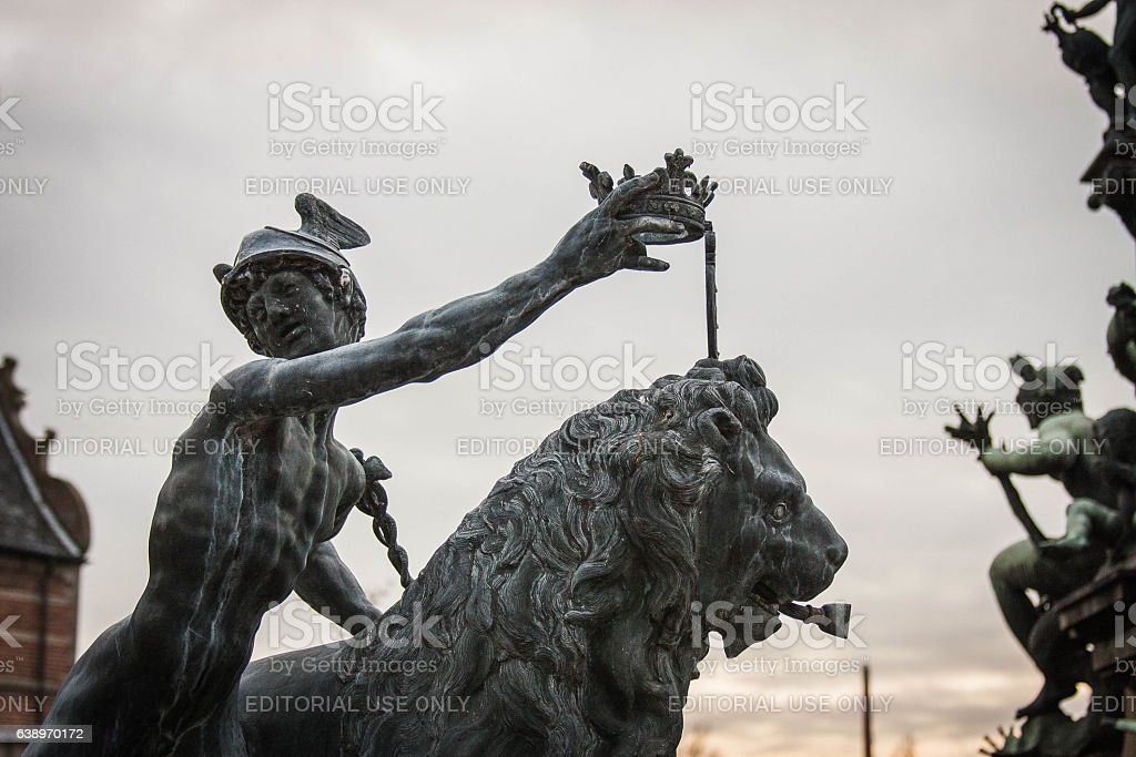 Frederiksborg Castle Neptune Fountain, Mercury crowning lion stock photo