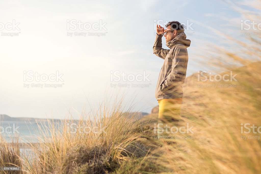 Free active man enjoying beauty of nature. stock photo
