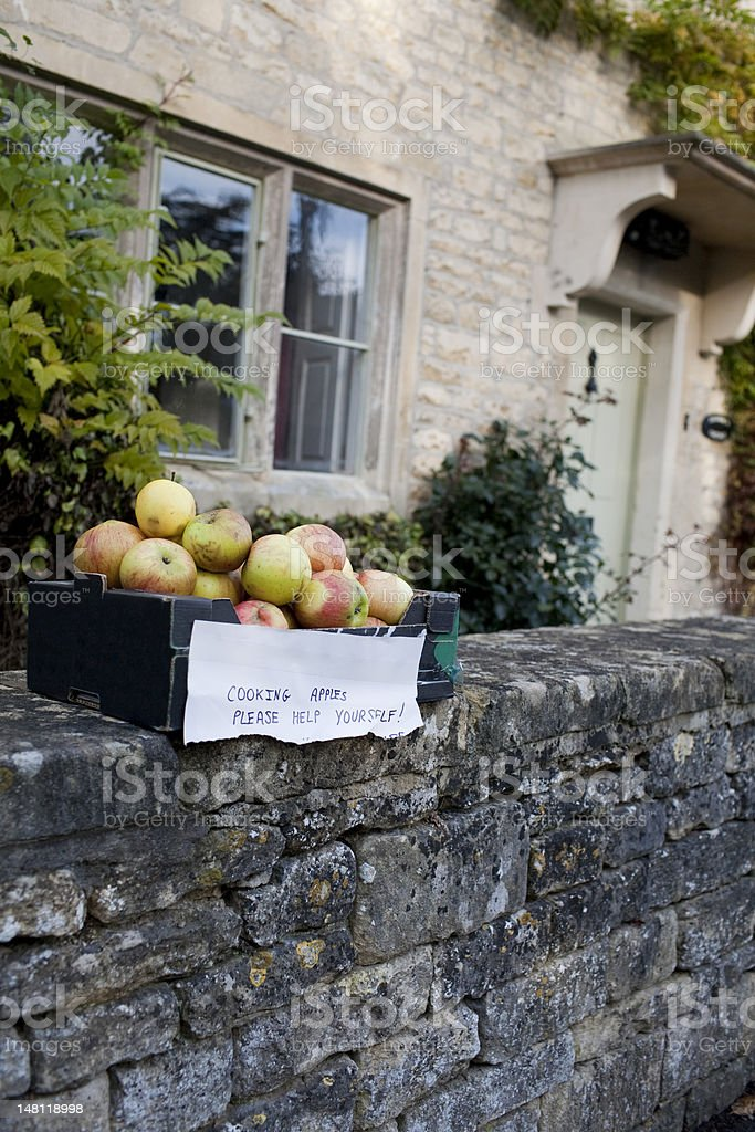 Free Autumn Cooking Apples sat on cotswold stone wall stock photo