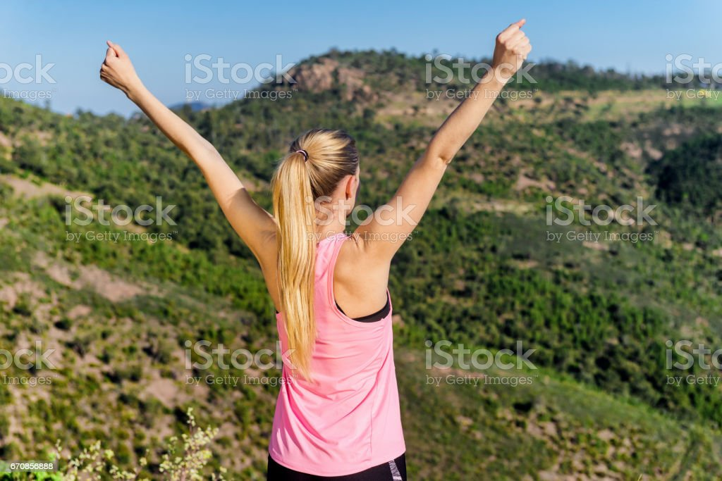 Free blond woman with open arms stock photo