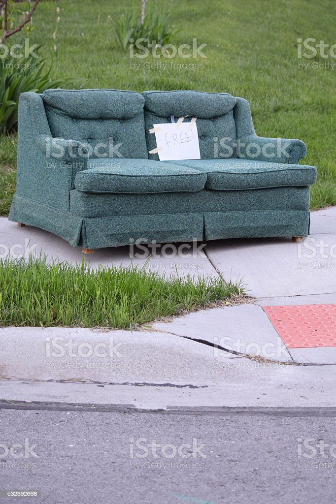 Free Couch on a Sidewalk stock photo
