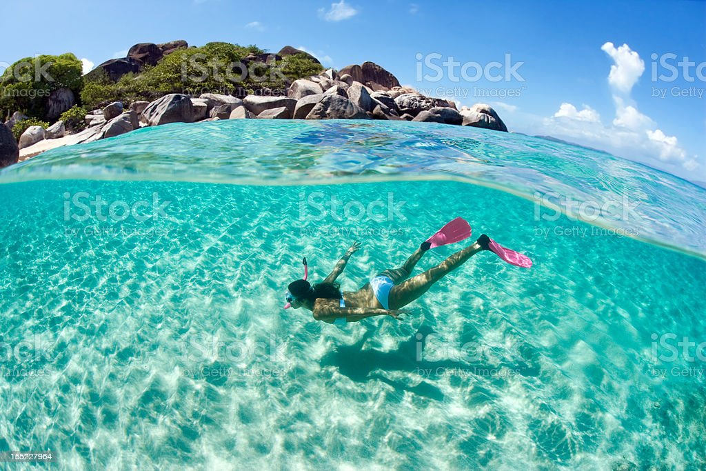 free diver woman snorkeling stock photo