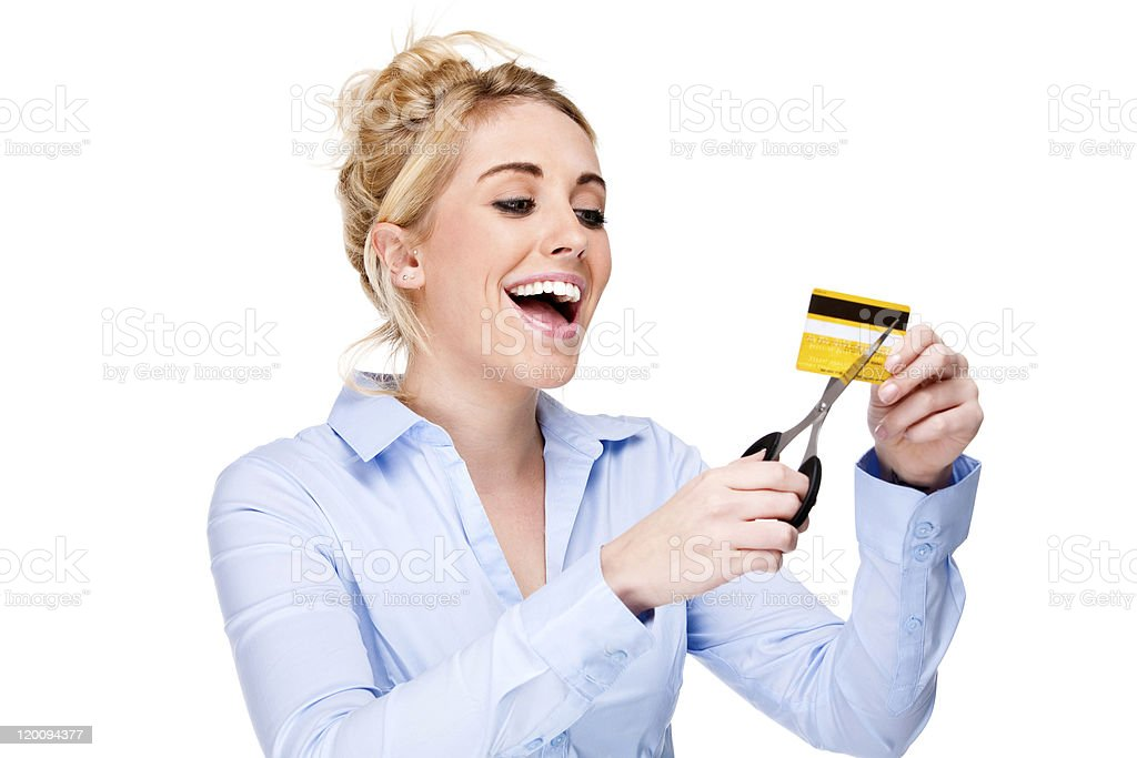 Free From Debt Attractive Woman Cutting Up Her Credit Card stock photo