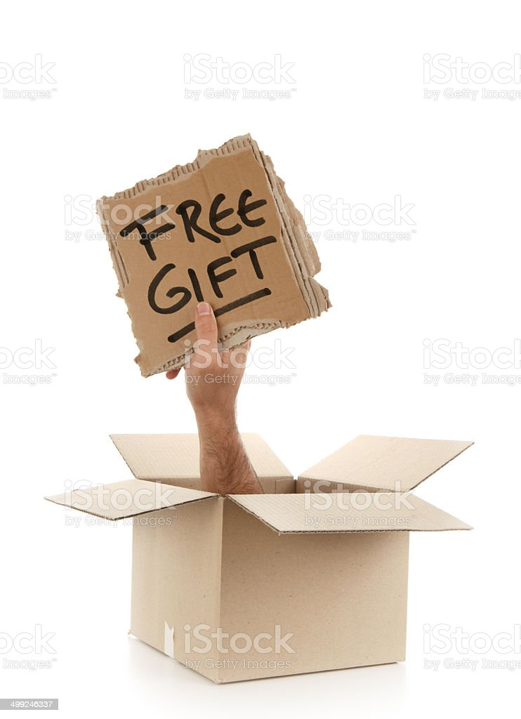 Free Gift - Sign Outside the Box on White Background royalty-free stock photo