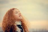 Free happy little girl enjoying nature, sunset