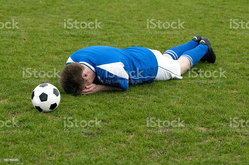 Free kick to soccer player injured on the field royalty-free stock photo