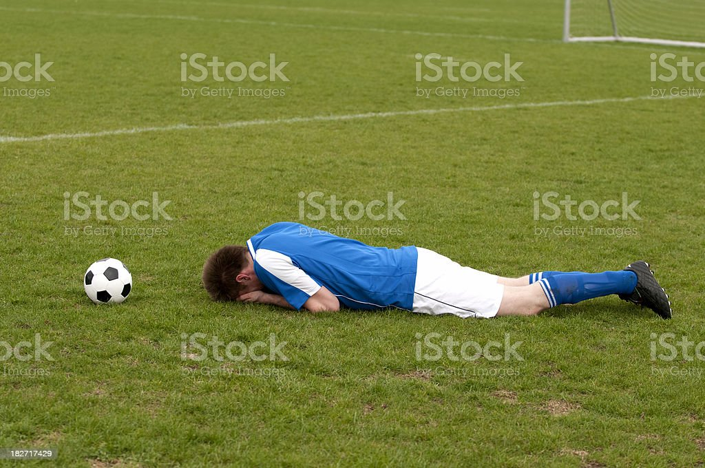 Free kick to soccer player who is left in pain royalty-free stock photo