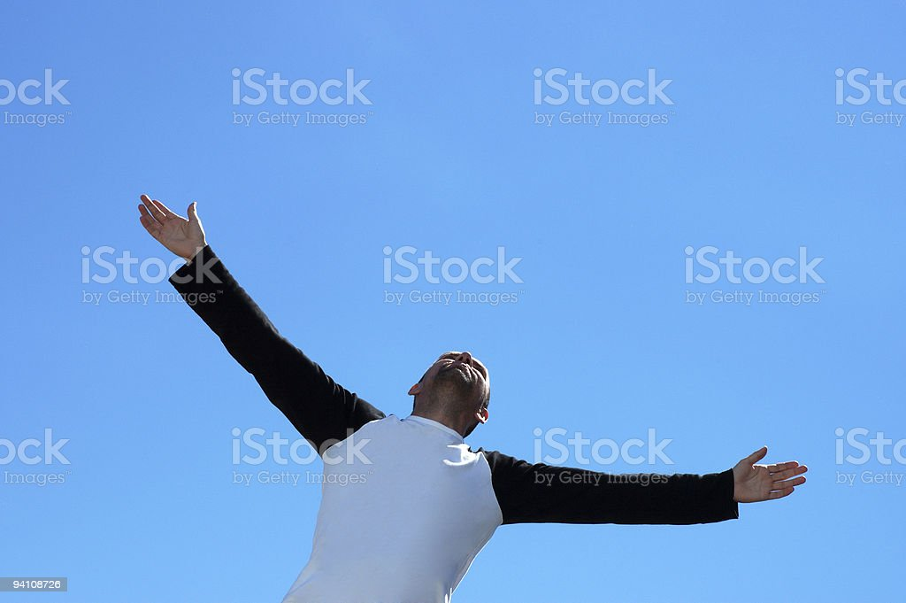 free  man on the sky background stock photo