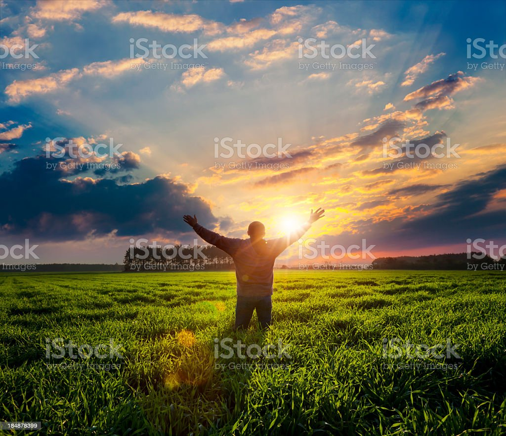Free man with raised hands. stock photo