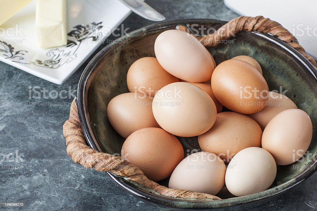 Free range brown eggs in a bowl stock photo
