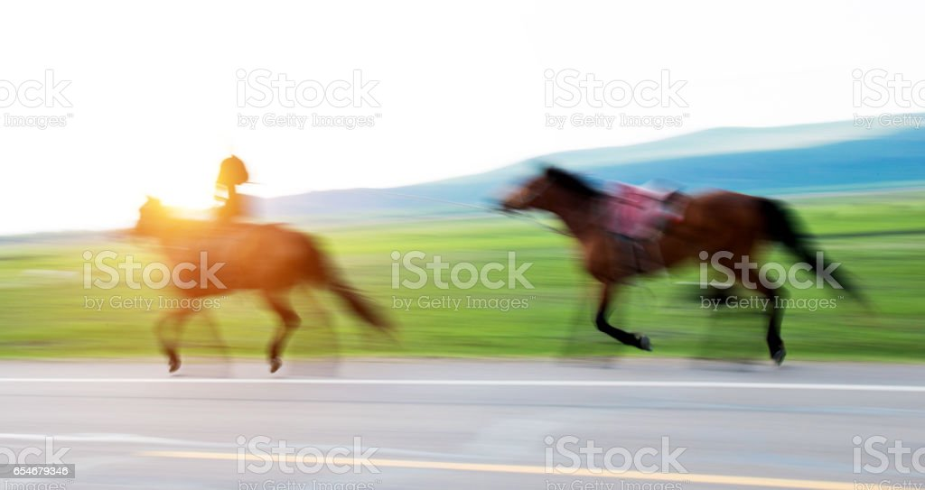 Free riding in the field stock photo