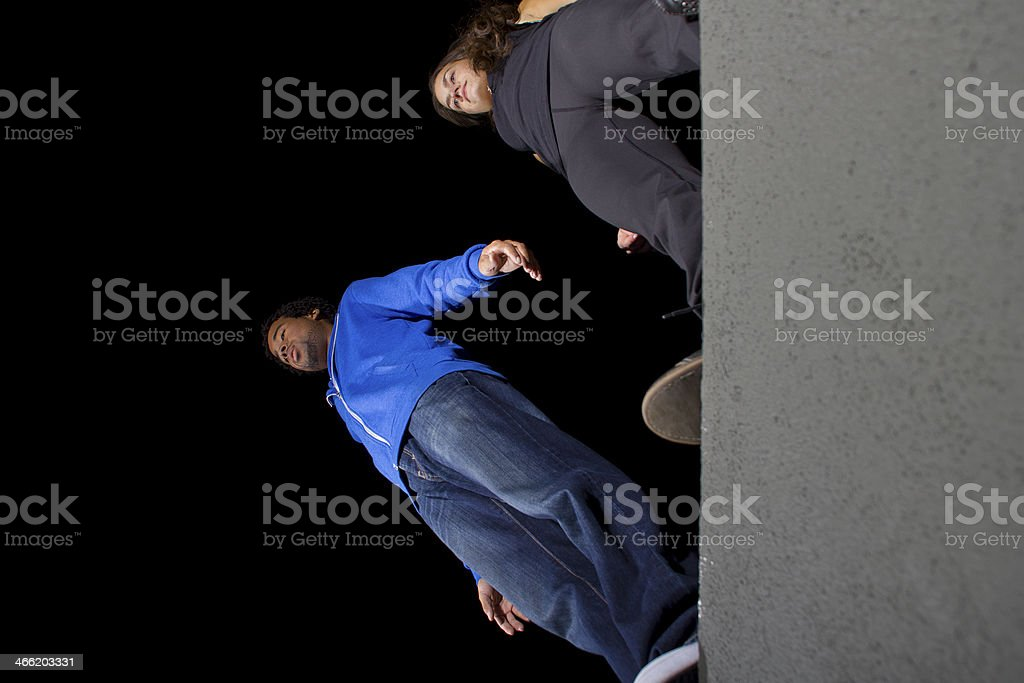 Free Runners Getting Ready To Do Parkour At Night royalty-free stock photo