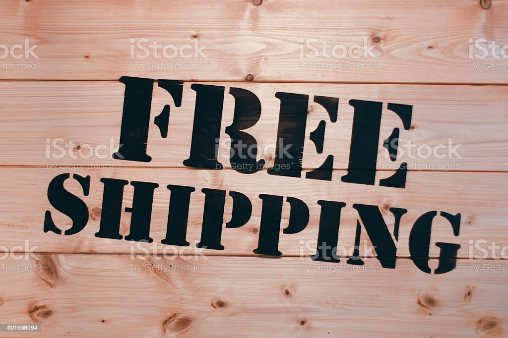 Free Shipping. Free Shipping word on wooden transport box. stock photo