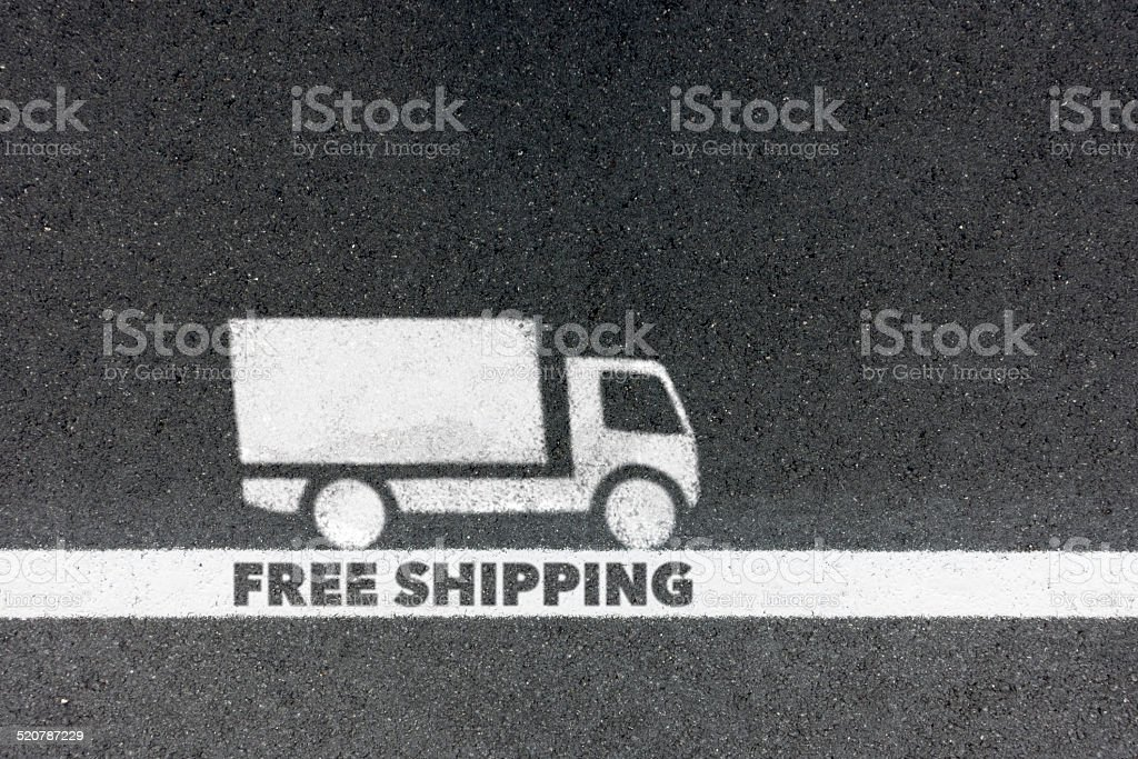 free shipping paint on asphalt and lane stock photo