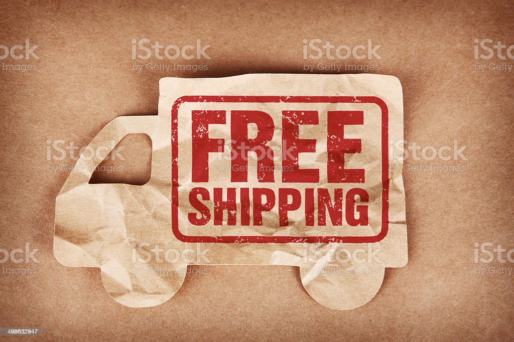 Free Shipping Stamped on Crumpled Cardboard Cutout Truck stock photo