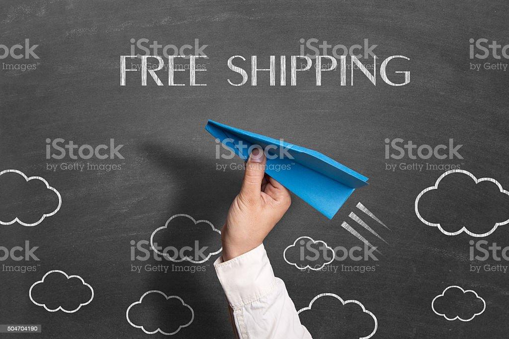 Free shipping text drawn on blackboard stock photo