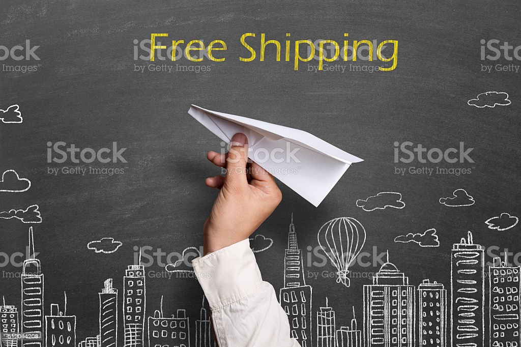 Free shipping text drawn on blackboard stock photo