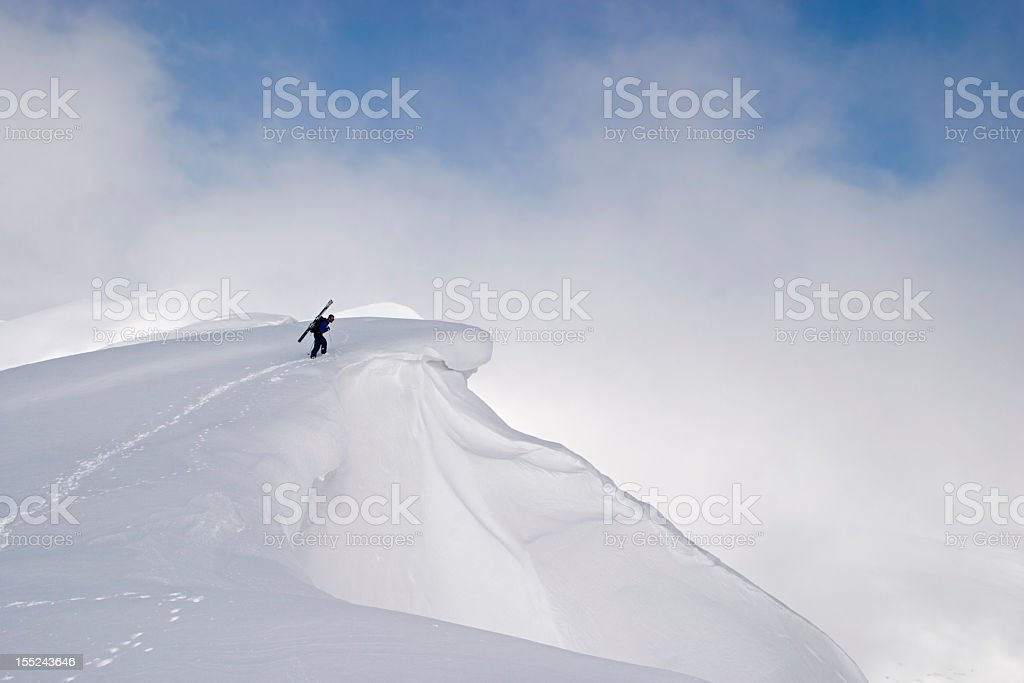 Free skier checking the terrain before a descent stock photo