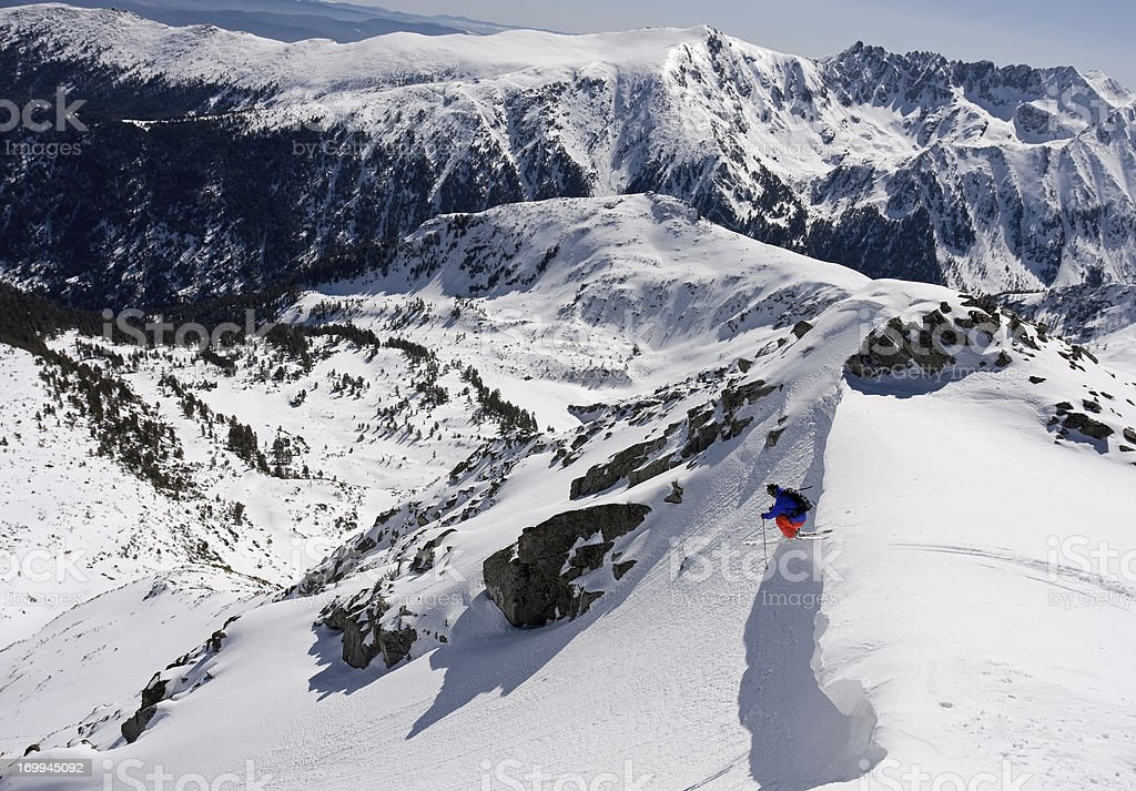Free skier starting his ride with a huge jump stock photo