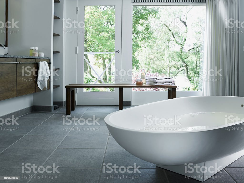 Free standing bathtub in corian stock photo