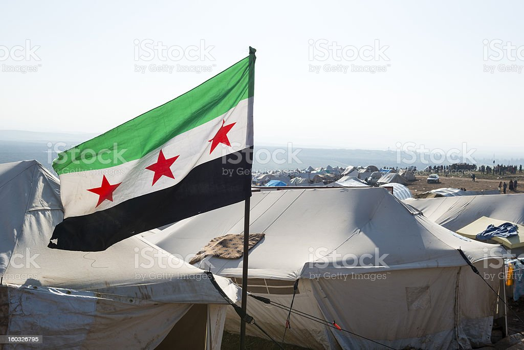 Free Syrian flag in refugee camp (Atmeh, Syria) stock photo