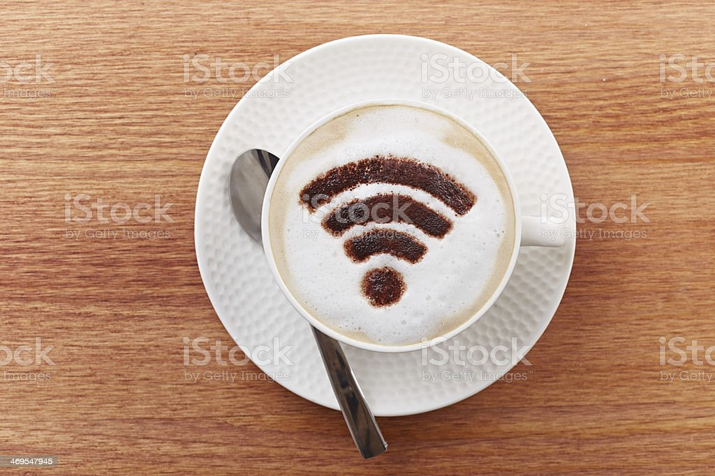 Free wifi area sign on a latte coffee royalty-free stock photo
