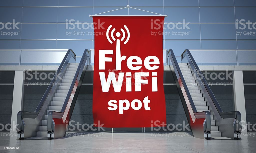 Free wifi spot advertising flag and escalator stock photo