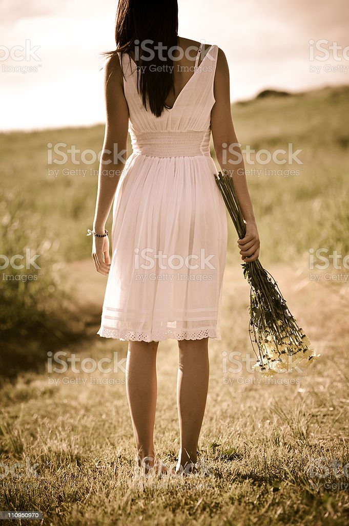 Free woman with bunch of flowers stock photo